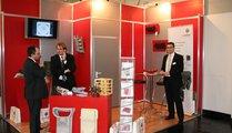 voxeljet technology GmbH, Germany Dipl.-Wirtsch.-Ing. Ulrich Schirmer / Sales (2nd left) and Martin Haugg / Sales (right)